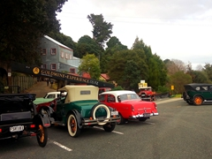 Antique cars in front of the Goldmine Experience; Coromandel Peninsula