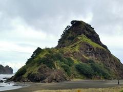 Lion rock, the famous landmark on Piha Beach