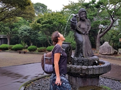 Becky takes a sip of water; Jeju Folklore & Natural History Museum