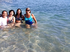 Becky enjoys a dip with her new friends Thai, Ying and Hai; Jungmun Beach