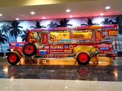 A jeepney on display at the Cebu airport. Jeepneys are the most popular means of public transportation in the Philippines (hot, crowded and cheap)