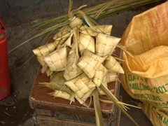 "Hanging rice or ""puso"" - a Cebu specialty of rice wrapped and boiled in a triangular casing made of woven coconut leaves"