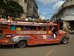 An overloaded jeepney; Carbon Market