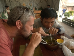 The boys slurping up lunch leftovers; House of Lechon