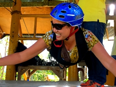 Becky smiling as she prepares to zipline across the Loboc River