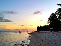 Sunset over Dumaluan Beach