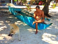 Dung Sau befriending a dog; Libaong Beach