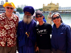 Bob, Long and Ann posing with a Sikh guard at the Golden Temple