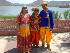 Indian tourists posing for photos near the water palace; Jaipur