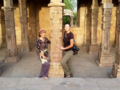 Di Phuong and Becky striking a pose with the carved columns of the Qutub Mosque