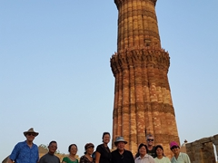 Family photo in front of the impressive Qutb Minar, the tallest brick minaret in the world