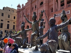 Bhangra Giddha Dance troupe statues near the Golden Temple in Amritsar