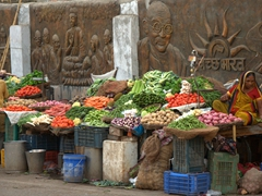 Gandhi looking over a vegetable seller; Varanasi