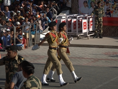 Two female border guards kick off the Wagah Border Ceremony to the crowd's delight
