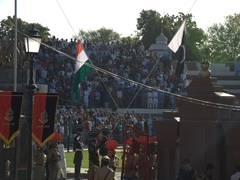 After much pomp bravado, the flags of India and Pakistan are lowered; Wagah Border Ceremony