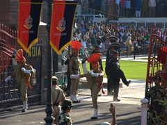 Soldiers performing a series of choreographed kicks  and stomps; Wagah Border Ceremony