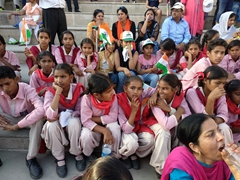 Indian school children look on in amusement at the Wagah Border Ceremony