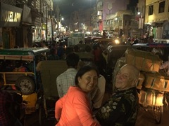 Ann and Bob smile as we sit patiently in the after-aarti traffic jam; Varanasi