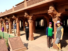 "Posing by the ground floor columns of ""Panch Mahal"", the wind-catcher tower of Fatehpur Sikri"