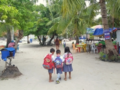 Uniformed school kids walking to school; Malapascua Island
