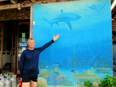 Posing next to a Thresher shark mural; Bounty Beach