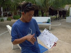 "Josh giving us the dive briefing for ""Deep Slope"", one of our favorite local dive spots"