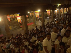 A massive crowd gathers to view the sacred tooth relic; Temple of the Tooth