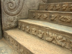 Dancing dwarfs carved into the Vatadage's staircase; Polonnaruwa