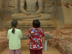 Chi Xuan and Di Tam gaze at the sitting Buddha; Gal Vihara