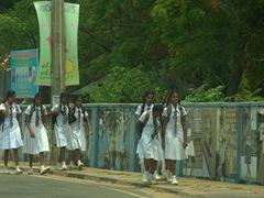 Uniformed school girls walking to school