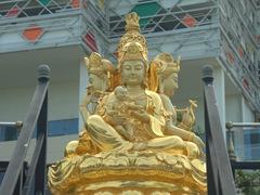 Golden statue near the entrance of late 19th century Seema Malaka Temple