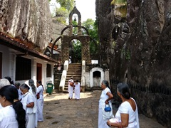 Pilgrims visiting the Aluvihare Rock Temple, located 30 KM north of Kandy in Matale