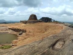 Panorama of the ruined Stupa and lake at the summit of Yapahuwa Rock