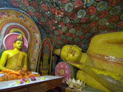 Beautiful frescoes and Buddha statues inside the monastery caves; Aluvihare Rock Temple