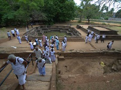Locals visit the King's swimming pool; Polonnaruwa