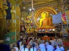 Buddhists praying inside Gangaramaya Temple