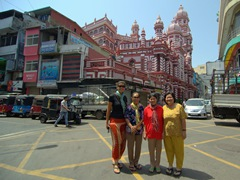 Posing in front of Jami Ul-Alfar Mosque, one of Colombo's most popular tourist sites