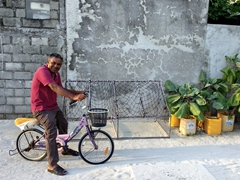 Friendly local on his pink bike; Dhiggaru Island