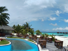 Panoramic view of the pool and waterfront guest bungalows; Filitheyo Island Resort