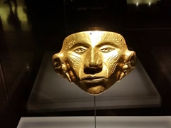 Gold face mask - notice the facial tattoo etchings