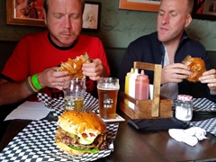 Lars and Matt dig in to their delicious burgers; Lobo Feroz in Cajica
