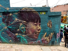 "Mural painted on a wall at """"Callejón del Embudo"", one of La Candelaria's most recognizable streets"