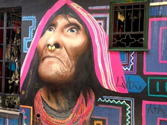 Mural of an indigenous woman looking up at the sky; Callejón del Embudo
