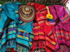 Colorful ponchos for sale; Monserrate