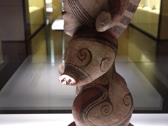 Clay pedastal figurine on display at the Gold Museum
