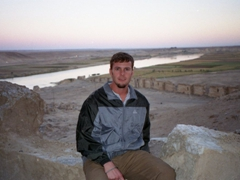 Robby watching the sun set over the Euphrates from the Fortress of Halabiye