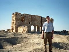 Robby smiling at Resafa (known in Roman times as Sergiopolis)