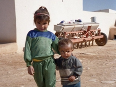 Cute kids pose for a photo, beehive village