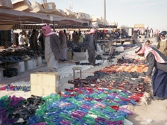 """Jelly shoes for sale at a roadside """"market"""""""