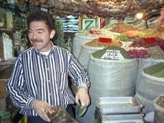 Friendly spice seller at the Hammadiyeh (Hamidiyah) Bazaar, Damascus